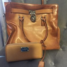 Michael Kors- Authenic This bag was loved. It's soft leather and it's two toned. Very very durable and a great bag. It will need some leather cleaner on it. It can be worn on your wrist or on your shoulder. It has two straps Michael Kors Bags Shoulder Bags