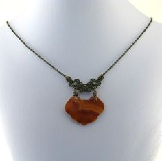 Maybe you'd prefer this view.  Carnelian Brass Necklace Slab Connector Chain by CinLynnBoutique, $29.00