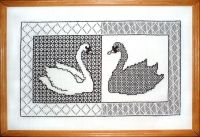 Who said swans are always white? Not in this design by Carol Leather which uses counterchange to create a black companion.
