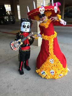 My wife suffered many burnt fingers for this. Our kids' The Book of Life Manolo & La Muerte costumes