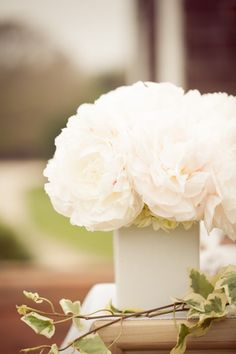 White Floral Arrangements Wrapped With Vine  #flowers #white #gardenparty by Twenty Three Layers (TTL Events). twentythreelayers.com