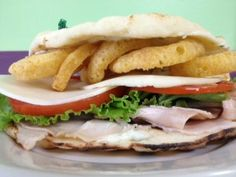 Good Monday Morning! We hope you're ready for another great week. Let's start it off by telling you about our lunch specials. Our first lunch special is a Roast Turkey Funwich; Bourbon Peppercorn Turkey placed on warmed Naan Bread topped with Provolone Cheese, Lettuce, Tomato, crispy Funions, and finished with a homemade Sage Mayo.