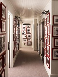 Hallway.  Shows long skinny hallway with gallery frames (in red!)