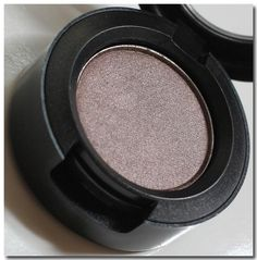 MAC Satin Taupe eyeshadow.  Shimmering multifaceted eyeshadow--taupey silver with a dash of bronze.