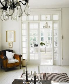 White floors, leather chair, french doors with transom. Door Design, House Design, Interior And Exterior, Interior Design, Interior Windows, French Interior, Modern Interior, Black And White Interior, Internal Doors