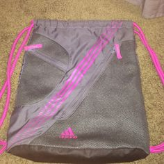 Adidas draw string bag ADIDAS draw string bag. Only flaw pointed out. Perfect to use for working out. Adidas Bags Backpacks