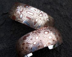 Mokumé gane is a fusion of two or more metals that, when manipulated by skilled hands, creates intriguing patterned stock coveted by jewelry designers and collectors alike. Phillip Baldwin, founder of Shining Wave Metals, are taking this Japanese craft to new heights.