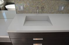 Beautiful Powder Room With Floating Onyx Countertop And Integrated - Integrated sink countertop bathroom
