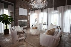 Shabby-Chic living room with chandelier, full-length white draperies, brick accent wall and a fireplace. Blanc Shabby Chic, Cocina Shabby Chic, Shabby Chic Mode, Style Shabby Chic, Country Style Living Room, Shabby Chic Decor Living Room, Shabby Chic Furniture, Vintage Furniture, Living Room Colors