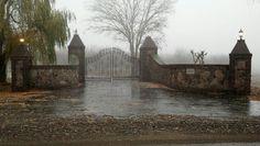 Driveway gate - stone columns, black wrought iron gate. Stunning Wrought Iron Driveway Gates, Driveway Entrance, Entrance Gates, Grand Entrance, Main Entrance, Stone Columns, Stone Walls, Stone Driveway, Fence Gate