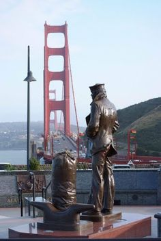 Lone Sailor Statue with the Golden Gate Bridge in the background. San Francisco.