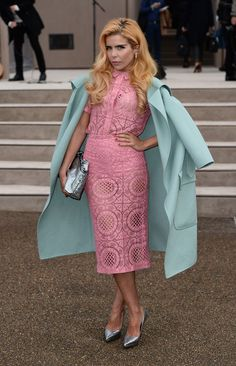 Paloma Faith layered a pastel blue wool coat over her pink ensemble for a colorful finish.