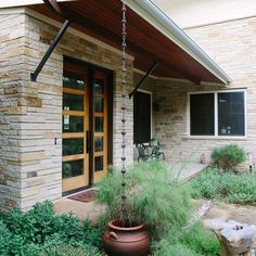We love how this simple container adds a dramatic look to this front home. Makes a huge difference!