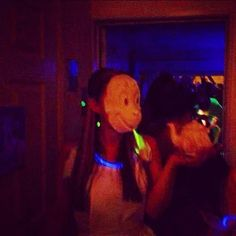 White animal masks and glow sticks plus a black light for a late night surrealist tea party