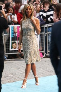 Jennifer Aniston Lookbook: Jennifer Aniston wearing Medium Straight Cut (21 of 40). America's sweetheart Jennifer Aniston lookd chic and glamorous at the 'Horrible Bosses' premiere wearing a white and silver Valentino cocktail dress. She finished off the look with exquisite heels and sleek blonde locks. Has this gorgeous star ever had a bad hair day?