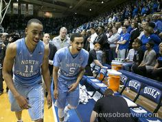 North Carolina's Brice Johnson (11)...and teammate Marcus Paige (5) celebrate the Tar Heels' 76-72 victory over Duke on Saturday, March 5, 2016 at Cameron Indoor in Durham, N.C.