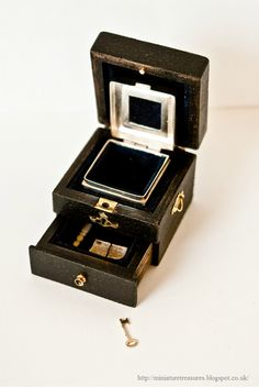 Amazing Ladies miniature travelling case at Miniature Treasures.  Bound letters and tiny ivory letter opener in the bottom drawer.