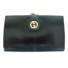 1970s Gucci lizard clutch wallet new in the box | From a collection of rare vintage handbags and purses at http://www.1stdibs.com/fashion/accessories/handbags-purses/