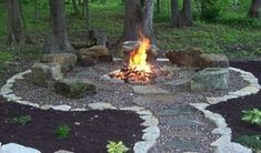 I plan on adding a fire pit to my garden this spring. I like the rock path.