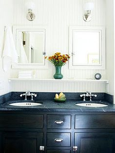 Crisp black and white bathroom. Love the symmetry with the double sinks, mirrors, and lights.