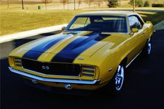 I'm so in love with the '69 Custom Coupe... especially with the paint job :)