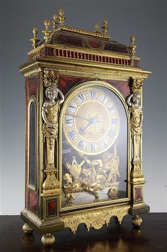 A Louis XV red tortoiseshell, silvered and gilt brass bracket clock, of architectural form, with caryatids flanking the gilt dial with enamelled tablet numerals, signed at the base of the dial Coquerel à Paris, with signed countwheel movement striking on a bell, 24.75in.