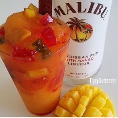 FRESH MANGO 3 oz. Of Rum with mango 1 cup of mango mix 1 cup of Ice Chamoy Tajin Gummy Bears Tamarind Straw