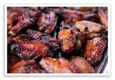 Roasted chicken wings.    1/2 cup unsalted butter  1 cup whole cane sugar or Sucanat  1/2 cup red wine  1/2 cup soy sauce  1/4 cup fresh lemon juice  2 teaspoons Dijon mustard  4 tablespoons hot sauce (if you like 'em spicy, add more)  4-5 pounds chicken wings  2 teaspoons sea salt  1/4 teaspoon black pepper  2 teaspoons garlic powder