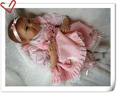 Nicery Morbido silicone Doll Reborn baby 22inch 55 centimetri magnetica Bocca bella realistica ragazzo sveglio giocattolo ragazza di fiore vestito rosa: Amazon.it: Giochi e giocattoli