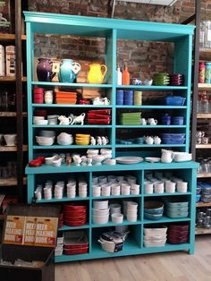 Whisk kitchen shop, New York store design. Pretty way to store & display kitchen items.