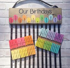 This colorful class birthday chart is the perfect way to display your students birthdays! It can be used year after year! Simply write each students name and the date of their birthday on a clip/clothes pin and clip it on the ribbon hanging under the month of their birth. This wood