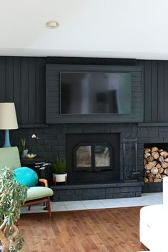 This post is about how to build a fireplace bump out to hang a TV and I'm so excited about this project because we solved a major problem with our living room arrangement. Even though our mantle was too high to hang the TV above the Above Fireplace Ideas, Painted Fireplace Mantels, Brick Fireplace Remodel, Tv Over Fireplace, Build A Fireplace, Paint Fireplace, Brick Fireplace Makeover, Farmhouse Fireplace, Cozy Fireplace