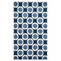 Rug with a geometric motif.  Product: RugConstruction Material: 100% PolyesterColor: Denim Note: Please be aware that actual colors may vary from those shown on your screen. Accent rugs may also not show the entire pattern that the corresponding area rugs have.Cleaning and Care: Clean spills immediately by blotting with a clean sponge or cloth. Vacuum carefully without beater bar. Expect shedding. Professional cleaning recommended. Rug pad recommended for use on hard floor.