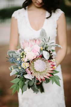 """The pop of blue eryngium gives this bouquet its """"eclecticness"""". Different style and texture mixes it up in the best way!  Moonrise Kingdom Inspired Wedding at Historic Cedarwood 