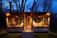 "eclectic porch by M Valdes Architects PLLC -- didn't know I needed a ""screened pavilion"" until I saw this"