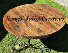 """RECYCLED WOOD PALLETS: We re-purposed this table with a new oak pallet top. This table is for sale for $115. It does not come with chairs. The overall dimensions of this table are, 31"""" tall with a 42"""" diameter. This could be used inside or outside. If you are going to use it outside it will need a couple of coats of poly. We have not added that. Message us.   Item # 983"""
