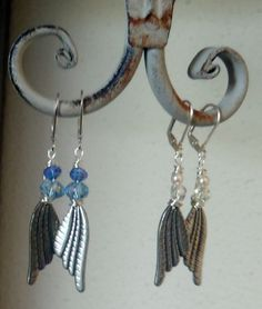 Earrings are designed and created by Mystic Angel Creations. Materials used: artisan grade wire, crystals, glass beads and pewter wings.