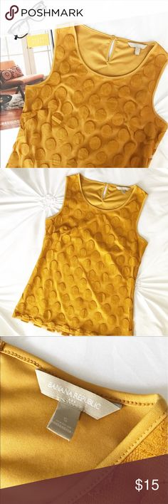 Banana Republic Polka Dot Tank in Marigold Polka dots make any wardrobe just a little bit better! This fun piece is a gorgeous gold/marigold color that is irresistible! The fun polka dot overlay gives it texture and dimension. Excellent condition! Buttons at the back of neck. Perfect for pattern mixing and layering too! Banana Republic Tops Tank Tops
