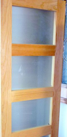 Another configuration of frosted glass and wood framing. How much fun it would be to replace the frosted glass with different colors! (Especially for a child's room)
