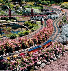 This pinner: My youngest grandson would love something like this. Previous pinner:Train Lady Garden Open House in Barrington, Illinois Ho Trains, Model Trains, Escala Ho, Garden Railroad, Model Train Layouts, Barrington Illinois, Scenery, Open House, Landscape