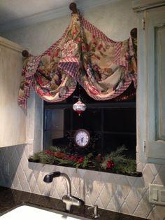 Lovely kitchen window. Love the window treatment.