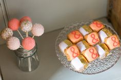 Cake pops and mini square cakes | peach wedding inspiration. For more inspiration visit www.weddingsite.co.uk