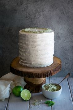 coconut mojito cake: This extraordinary cake comes from Tessa Huff's @stylesweetca gorgeous new book, Layered. Three layers of fluffy lime cake made with freshly grated lime zest are lightly brushed with a mint rum simple syrup that is cool and refreshing. Surrounded by a creamy coconut rum frosting, each layer of this pillowy cake is topped with a tangy lime filling: a smooth swiss meringue buttercream made with lime juice and lime zest. And it doesn't stop there!