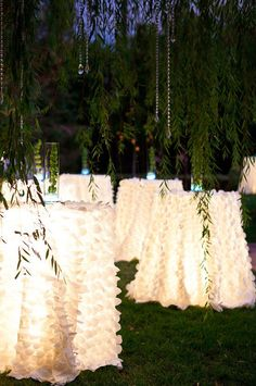 By adding lighting under your tables, your outdoor wedding will have a magical glow. This option is especially good if you're having tall tables so guests can stand around and mingle or dance the night away. | Under-Table Lighting | Unique Lighting Ideas for an Outdoor Wedding | My Wedding Favors