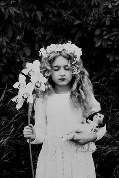 A 'flower girl' holding her doll. (Hommage à Cornell). Dark Photography, Children Photography, Black And White Photography, Saint Yves, Art Tumblr, Colette, Time Pictures, Child Doll, Vintage Girls