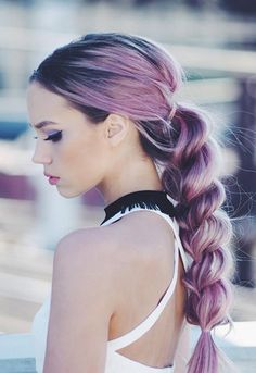 Kirsten Zellers with pink hair in a plait