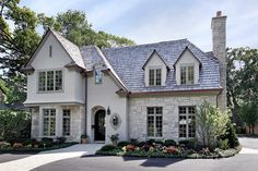 Feature Friday: Kolbe windows blend into the stone and stucco exterior of this award-winning home, built by Birchwood Builders.