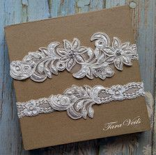 Wedding garter set, bridal garter set, bridal garter, toss garter Floral Lace and Pearl. This delicate garter set is made Light Ivory floral lace, Pearl and Floral elastic. This piece measures about 6.5 X 2.3/4 on its wider at the widest point. Purchase this item and we will ship it in next 48 hours via USPS Priority mail (3-5 business days).  Please review this shops return policy before placing your order, as all sales are final: http://www.etsy.com/shop/TaraVeils/policy