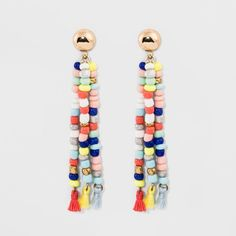 The SUGARFIX by BaubleBar Beaded Drop Earrings with Tassels combine two of our favorite trends: color and tassels. A playful take on mixed media, these earrings show especially well with upswept tresses (though we love them with tousled tresses just the same).