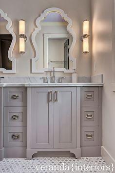 gray double vanity design; gray marble counters; Sunflower Carrara Thassos tile floor